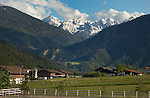 Alpine farm against snow covered mountains,Imst district, Tyrol/Tirol, Austria, Alps.