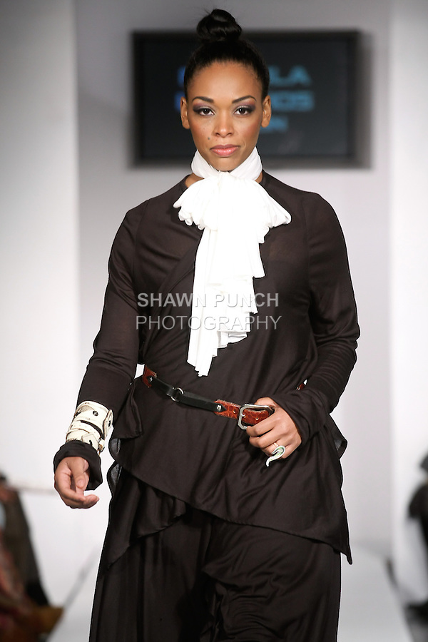 Model walks runway in an outfit from the Fotoula Lambrous Design Fall Winter 2012 collection by, Fotoula Lambros, during BK Fashion Weekend Fall Winter 2012.