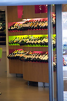 Wine shop. Modern, owned by JL thunevin, bottles on colourful shelves. The town. Saint Emilion, Bordeaux, France