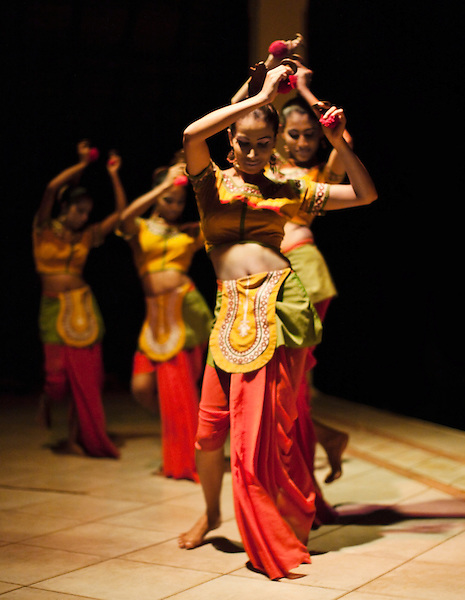 "Young women from the Ruhunu Ballet and Dance Academy performing a Sri Lankan folk dance traditionally known as ""Thalam Netuma"" at Saman Villas, Aturuwella, Bentota, Sri Lanka. This dance is performed to the tune of folk music played with traditional musical instruments."
