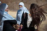 Druze women wait at Quneitra border-crossing in Israel-Syria border, upon the return of Druze students from their studies at Damascus University in Syria.