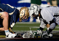 John Schiavone (39) of Loyola faces off with Trever Sipperly (7) of Notre Dame during the Face-Off Classic in at M&T Stadium in Baltimore, MD