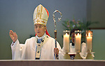 Archbishop Joseph Mitsuaki Takami delivers the benediction at the end of a special mass for peace in Nagasaki, Japan, on August 9, 2015, the 70th anniversary of the day the United States dropped an atomic bomb on the city. Las Cruces, New Mexico, Bishop Oscar Cantu delivered the homily.