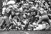 Chicago Bear's Gayle Sayers running, San Francisco 49ers #80 Stan Hindman, #60 Roland Lakes, and #64 Dave Wilcox..(1967 photo/Ron Riesterer)