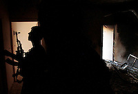 Free Syria Army soldiers move into position to attack a building housing several Assad forces during urban fighting in the al-Amaria district of Aleppo. House-to-house combat using tunnels punched through buildings is one of the classical tactics of urban warfare in the city of Aleppo. Aleppo, Syria. September 20, 2012...© Javier Manzano.