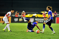 John Brooks (middle) of USA hits the ground after a collision. USA defeated Peru 2-1 during a Friendly Match at the RFK Stadium in Washington, D.C. on Friday, September 4, 2015.  Alan P. Santos/DC Sports Box