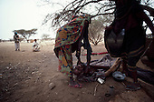 liberated Eritrea..February 1985....A woman that left her home with two children, migrated to a camp in Eritrean Peoples Liberation Front (EPLF) held territory only for her and her older child to die of starvation. Her younger child survived.....Her body is washed in a ceremonial fashion before burial...