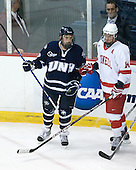 Phil DeSimone (UNH - 39), Riley Nash (Cornell - 14) - The University of New Hampshire Wildcats defeated the Cornell University Big Red 6-2 (EN) on Friday, March 26, 2010, in their NCAA East Regional semi-final at the Times Union Center in Albany, New York.