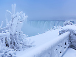 Niagara Falls Horseshoe waterfall covered with snow and ice, wintertime scenery. Ontario, Canada.