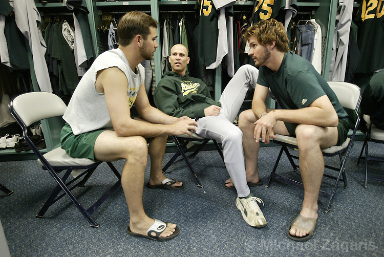 BOSTON, MA - OCT 4:  Ted Lilly, Tim Hudson and Barry Zito pregame at Fenway Park on Oct 4, 2003 in Boston, MA. The Red Sox defeated the Athletics 3-1. ....(Photo by Michael Zagaris/MLB Photos)