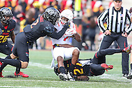 College Park, MD - November 26, 2016: Rutgers Scarlet Knights running back Robert Martin (7) gets tackled by several Maryland Terrapins defenders during game between Rutgers and Maryland at  Capital One Field at Maryland Stadium in College Park, MD.  (Photo by Elliott Brown/Media Images International)
