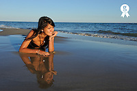 Young Woman lying on the sand, by beach at dusk (Licence this image exclusively with Getty: http://www.gettyimages.com/detail/105765530 )