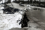 A truck drives past an eroded US 98 outside of Eastpoint, Florida after  Hurricane Kate slammed the Florida panhandle near Apalachicola, Florida November 21, 1985.  Kate, a late November Hurricane,  was latest forming Atlantic hurricane on record at the time and was the second for the area following Hurricane Elena two months earlier.