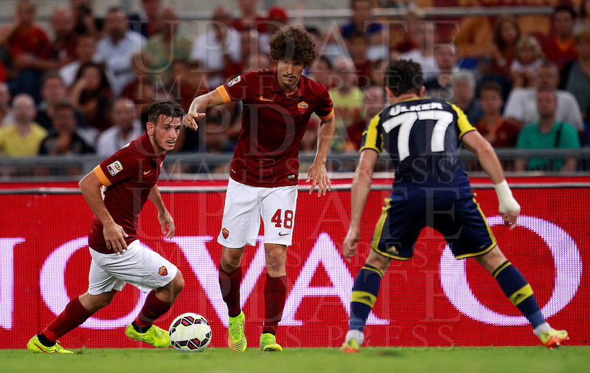 Calcio, amichevole Roma vs Fenerbahce. Roma, stadio Olimpico, 19 agosto 2014.<br /> Roma midfielder Salih Ucan, of Turkey, center, is challenged by Fenerbache midfielder Gokhan Gonul, right, during the friendly match between AS Roma and Fenerbahce at Rome's Olympic stadium, 19 August 2014. At left, Roma midfielder Alessandro Florenzi.<br /> UPDATE IMAGES PRESS/Isabella Bonotto