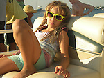 Girl with sunglasses on a yacht at sunset.<br /> Block Island, Rhode Island