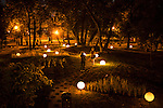 Two women take a picture among an array of illuminated globes in Gorky Park on Saturday, August 17, 2013 in Moscow, Russia.