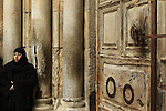 Jerusalem Old City, the closed doors of the Church of the Holy Sepulchre before the Good Friday ceremony