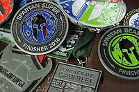 NWA Democrat-Gazette/ANDY SHUPE<br /> The Rev. Steve Sheely, pastor of Rolling Hills Baptist Church in Fayetteville, displays some of the medals he earned Wednesday, June 1, 2016, while competing in the races that he takes part in.