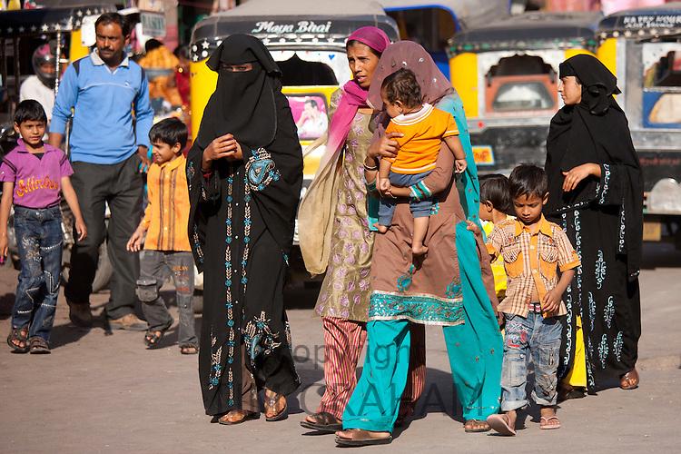 Crowded street scene Muslim people at Sardar Market at Girdikot, Jodhpur, Rajasthan, Northern India