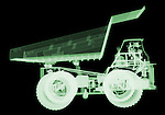 X-ray image of a mining dump truck (green on black) by Jim Wehtje, specialist in x-ray art and design images.