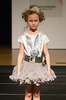 Model walks runway in an outfit by Angel's Face, during the petitePARADE Children's Club fashion show at the Jacob Javits Center in New York City, on January 9, 2016.