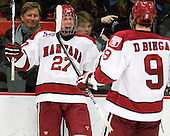 Michael Biega (Harvard - 27) and Danny Biega (Harvard - 9) celebrate Michael Biega's goal. - The Harvard University Crimson defeated the St. Lawrence University Saints 4-3 on senior night Saturday, February 26, 2011, at Bright Hockey Center in Cambridge, Massachusetts.
