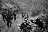 Dulzura, California<br /> USA<br /> August 16, 2007<br /> <br /> A special operations border patrol that is air-mobile and moves into hot areas in southern California to capture illegal immigrants sets up a trap just east of San Ysidro and north of the Mexican border.<br /> <br /> Within minutes of their arrival  - a five men team, located on the mountain ridge, spots a group heading for the border.<br /> <br /> The Border Patrol hides in the bushes and jump them as they cross into the USA. The Mexican's are loaded into a Border Patrol truck.