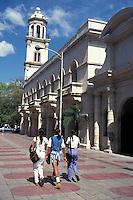 Three yound women walking along Calle El Conde  in old Santo Domingo, Dominican Republic.