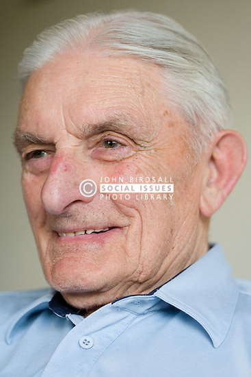 Portrait of an older man smiling,