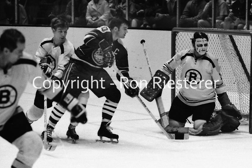 Boston Bruins vs California Golden Seals, NHL hockey.<br />Bruins Bobby Orr and goalie Eddie Johnston, Seals Ted Hampson. (1970 photo/Ron Riesterer)