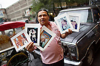 A man sells pictures of famous Luchadores (fighters) outside the Arena Mexico before a Lucha Libre match. Lucha Libre is a style of wrestling started in Mexico in 1933. The name means Free Fight, and matches tend to be focussed on spectacle and theatre with fans cheering for their favourite characters, who wear masks while jumping from the ropes, flipping opponents, and occasionally crashing into the crowd..&copy;Jacob Silberberg/Panos/Felix Features.