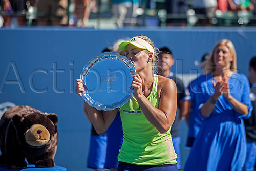 09.08.2015. Stanford, California, USA.  Angelique Kerber (GER) kisses her trophy during the awards ceremony after the finals of the Bank of the West Classic at Stanford University's Taube Family Tennis Center in Stanford, Calif. Kerber defeated Pliskova 2 sets to 1 to become the 2015 Bank of the West Classic.