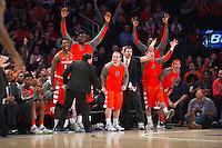 NEW YORK, NY - Sunday December 13, 2015: The Syracuse bench celebrates a big point.  St. John's defeats Syracuse 84-72 during the NCAA men's basketball regular season at Madison Square Garden in New York City.