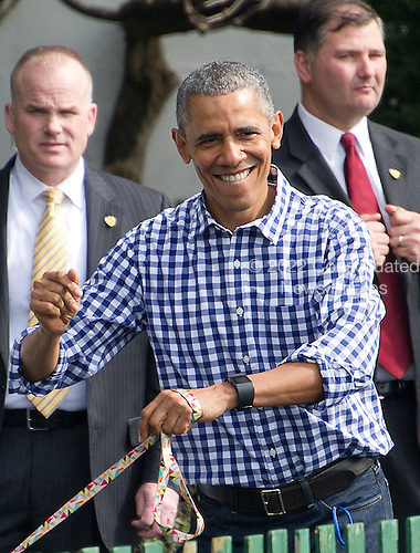 United States President Barack Obama smiles towards participants as he and first lady Michelle Obama host the 2016 White House Easter Egg Roll on the South Lawn of the White House in Washington, DC on Monday, March 28, 2016.<br /> Credit: Ron Sachs / CNP