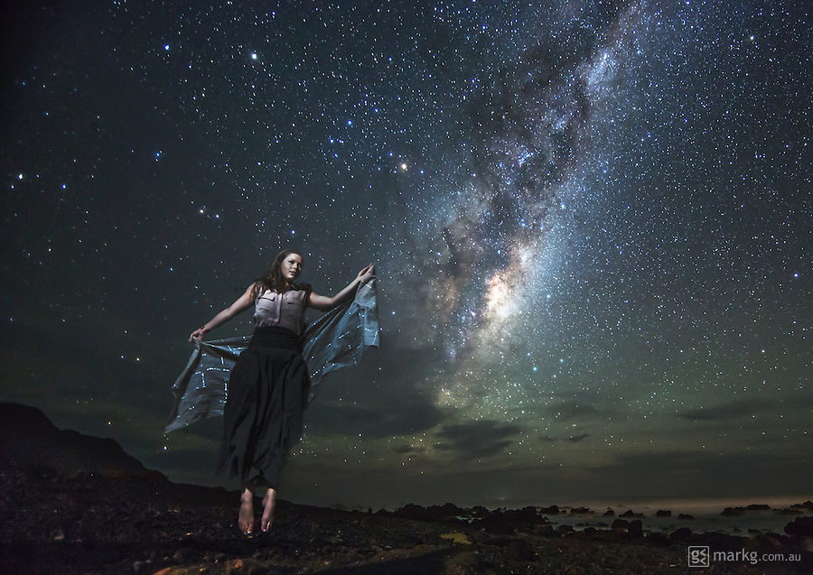 This image is a composite of a foreground and background element. Both elements were shot through the same camera and lens and in the same position only minutes apart. For the foreground element, the shutter speed was increased to capture Sarah mid leap into the air. And for the background element, the shutter was slowed down again to 30 seconds to capture the night sky and Milky Way. The aperture and ISO remained the same during both shots. The two elements were then composited together in Photoshop.