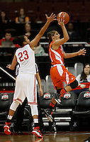 Bowling Green Falcons guard Jillian Halfhill (11) drives past Ohio State Buckeyes forward Martina Ellerbe (23) in the first half at Value City Arena in Columbus Nov. 24, 2013.(Dispatch photo by Eric Albrecht)