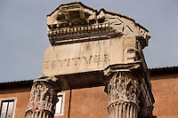 Three Corinthian columns supporting an architrave with friezes showing sacrificial objects, Temple of Vespasian, by Domitian in 81 AD in honour of his father Vespasian and his brother Titus, Roman Forum, Roma, Italy, Europe.