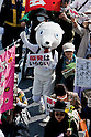 Tokyo, Japan - A photo made available on April 11 shows a protestor  marching at a rally in downtown Tokyo in aims to shut down the Hamaoka Nuclear Power Plant, in Nagoya, Japan, 10 April 2011. Thousands of protestors demanded the immediate closure of the plant due to the nuclear crisis Japan is struggling with of the quake-hit Daiichi Nuclear Power Plant in Fukushima. The Hamaoka plant is built on top of the junction of tectonic plates in the Tokai area which is considered to be the area of concern for a major earthquake in the unforeseeable future. (Photo by Christopher Jue/AFLO) [2331]