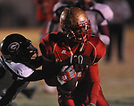 Lafayette High's Demarkous Dennis (5) fumbles vs. Greenwood High in MHSAA playoff action in Oxford, Miss. on Friday, November 11, 2011. Lafayette High won 53-8.