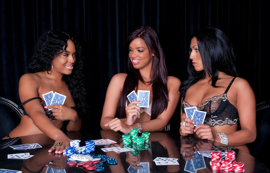 Young womans playing poker in lingerie very happy.