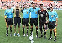 Santino Quaranta #25 of D.C. United and Danny Califf #4 of the Philadelphia Union poses with the game officials before an MLS match at RFK Stadium on August 22 2010, in Washington DC.
