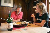 Ratikon, Vorarlberg, Austria, August 2010. Huttenwirt Wilfried Studer brings out the kaiserschmarrn and the red wine for dinner, while he tells about his ascent of Mt Everest. A classical 5 day high alpine hiking tour goes up from the village of Brand to the Oberzalim hut, the Mannheimer hut, over the Schesaplana to the Totalp hut, past lake Lunersee to the Lindauer hut and out to the village of Latschau. Photo by Frits Meyst/Adventure4ever.com