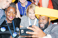 News correspondent Katie Couric poses for a selfie with Wisconsin delegates wearing cheesehead hats on the final day of the Democratic National Convention at the Wells Fargo Center in Philadelphia, Pennsylvania, on Thurs., July 28, 2016.