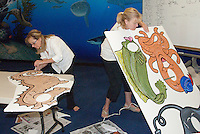 Heal the Bay volunteers Marjorie Kay (left) and Ann Casebier make animal cutouts at the Santa Monica Pier Aquarium on Thursday, June 30, 2010. The cutouts will be used in an upcoming Ocean Appreciation weekend on July 30 and 31 at the  Santa Monica Pier Aquarium.
