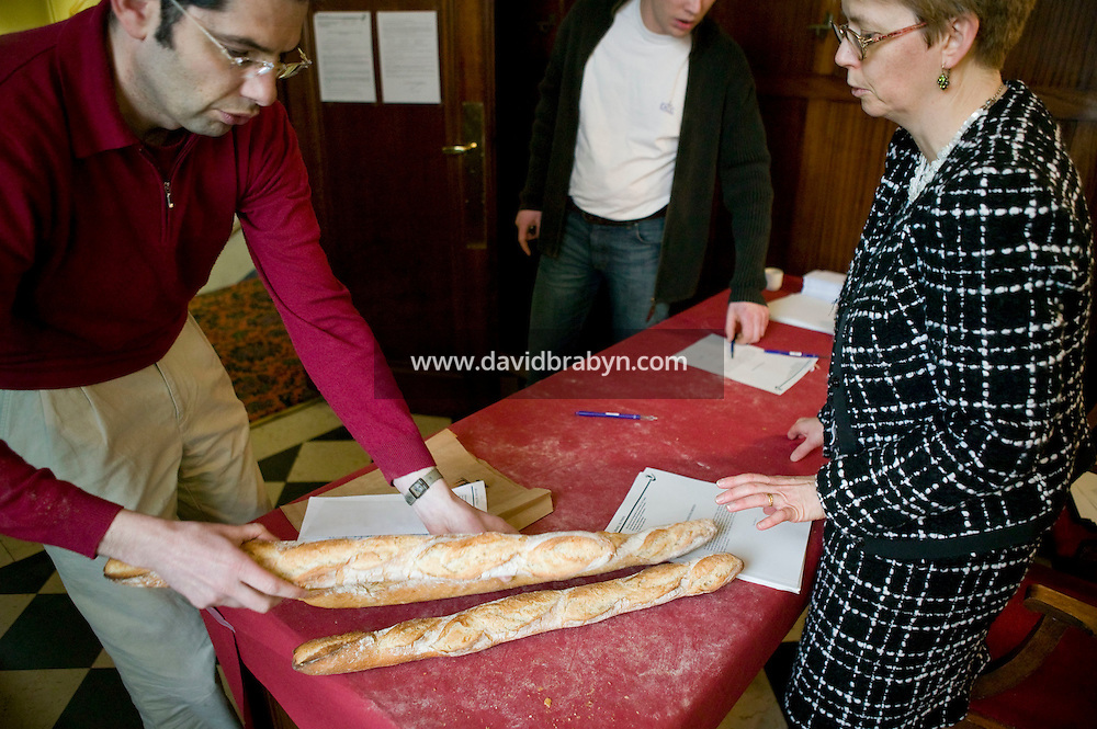 "A baker registers two baguettes for the Best Baguette in Paris contest in Paris, France, 5 January 2004. 120 bakers competed in the 2004 edition of the prestigious annual Grand Prix de la Baguette. The title went to Pierre Thilloux from ""La Fournée d?Augustine"" bakery in the 14th arrondissement of Paris."