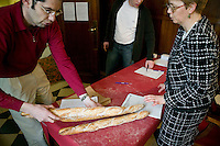 """A baker registers two baguettes for the Best Baguette in Paris contest in Paris, France, 5 January 2004. 120 bakers competed in the 2004 edition of the prestigious annual Grand Prix de la Baguette. The title went to Pierre Thilloux from """"La Fournée d?Augustine"""" bakery in the 14th arrondissement of Paris."""