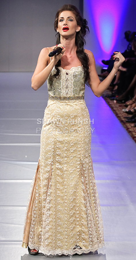 Opera singer and model Veronica Iovan, sings during Couture Fashion Week, Spring 2012.