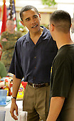 Honolulu, HI - December 25, 2008 -- United States President-elect Barack Obama greets a United States Marine at a Christmas dinner at Anderson Hall located at Marine Corps Base Hawaii Kaneohe Bay on Thursday, December 25, 2008 in Honolulu, Hawaii. Obama and his family arrived in his native Hawaii December 20 with his family for the Christmas holiday.  .Credit: Kent Nishimura / Pool via CNP