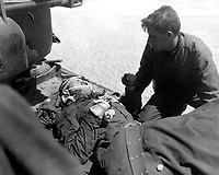 Crew members of Co. D, 89th Tank Bn., give first aid to wounded soldier, during action against the Chinese Communist forces north east of Seoul, Korea.  May 1, 1951.  Pfc. Charles Fabiszak. (Army)<br /> NARA FILE #  III-SC-366309<br /> WAR &amp; CONFLICT BOOK #:  1452