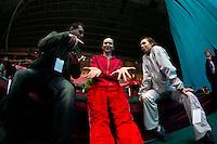 "(Center) Liubov Charkashina and (R) Inna Zhukova of Belarus smile for camera before 2008 World Cup Kiev, ""Deriugina Cup"" in Kiev, Ukraine on March 21, 2008."